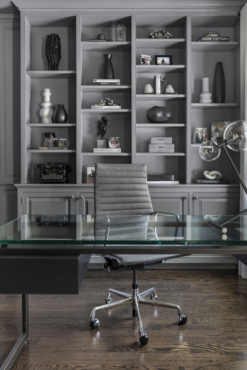 home-office-glass-desk-built-in-shelves-monochromatic-interior-design