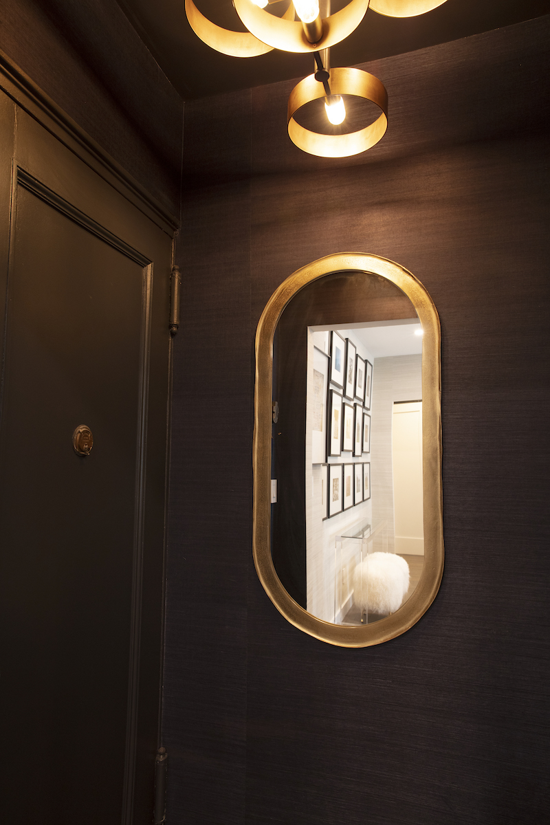 entryway-apartment-black-paint-oval-gold-mirror
