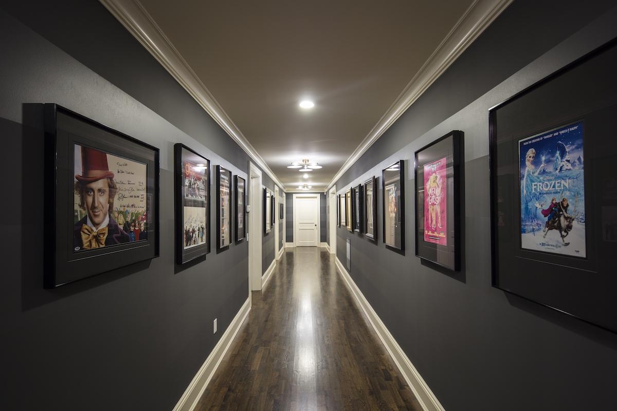 gallery-wall-hallway-dark-walls-black-frames