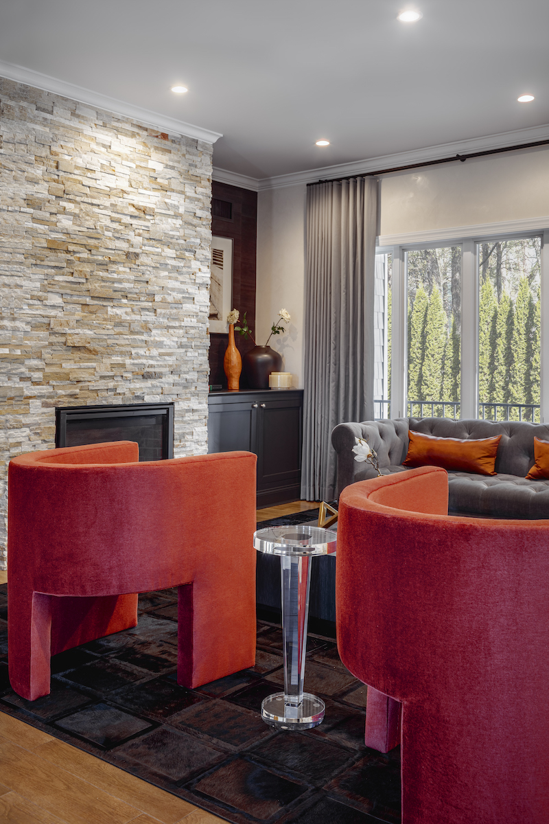 living-room-design-stone-fireplace-red-accent-chairs-2