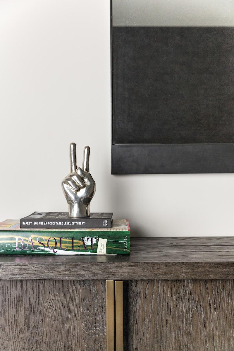 peace-sign-hand-paper-weight-decor-books-interior-design