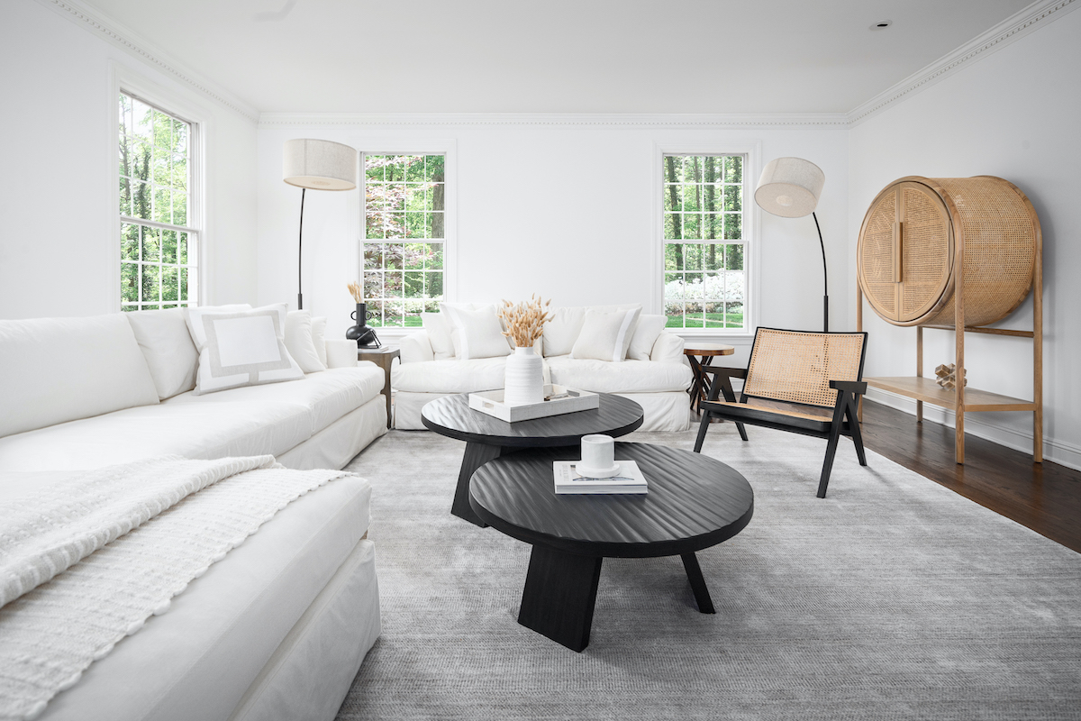 living-room-interior-design-new-canaan-ct-white-couch-black-coffee-tables